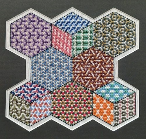 hexagonal cross-stitch symmetry sampler